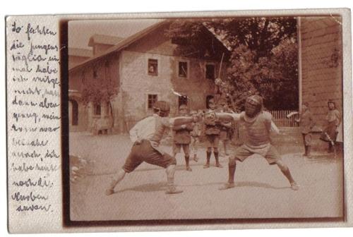 German boys fencing with the basket-hilt saber
