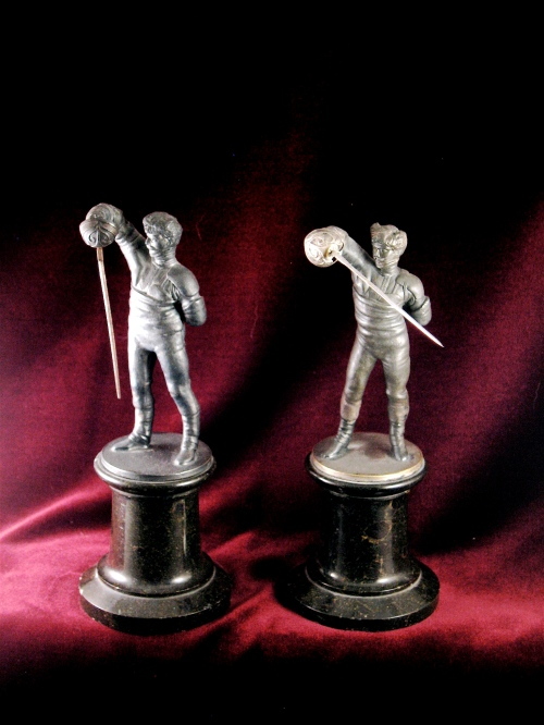 Statuettes of Mensur fencers